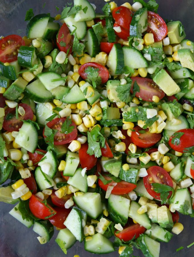 Summer blast salad in a bowl with corn, tomato, cucumber