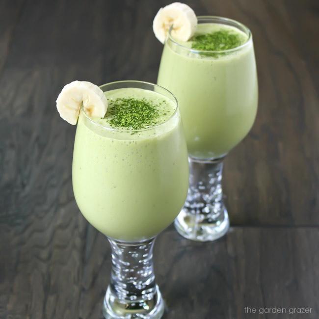 Two glasses of vegan coconut vanilla matcha smoothies