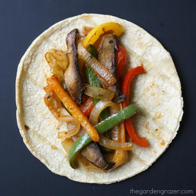 Portobello mushroom fajitas with colorful bell peppers on a corn tortilla