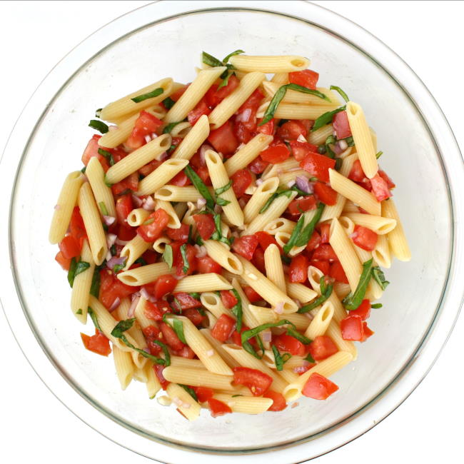 Vegan fresh summer pasta in a glass bowl