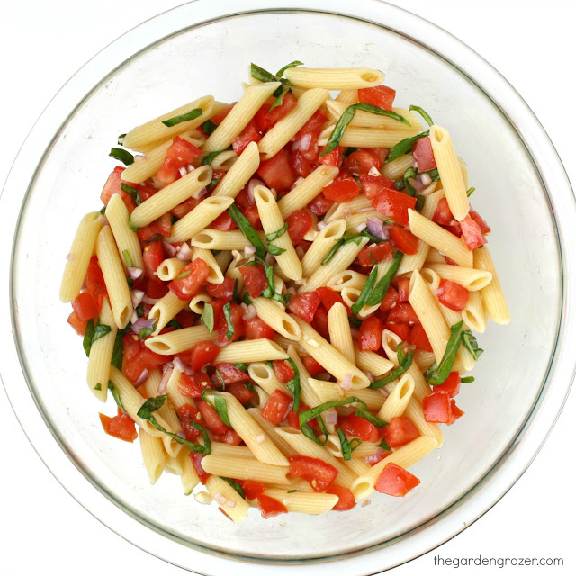 Fresh tomato basil pasta in a glass bowl