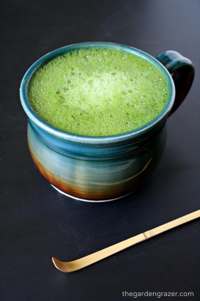 Vegan soy matcha latte with vanilla in a large mug