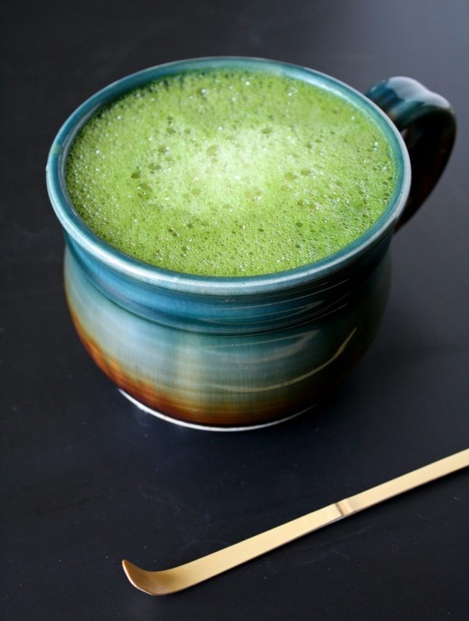 Vegan soy matcha latte with vanilla in a large mug
