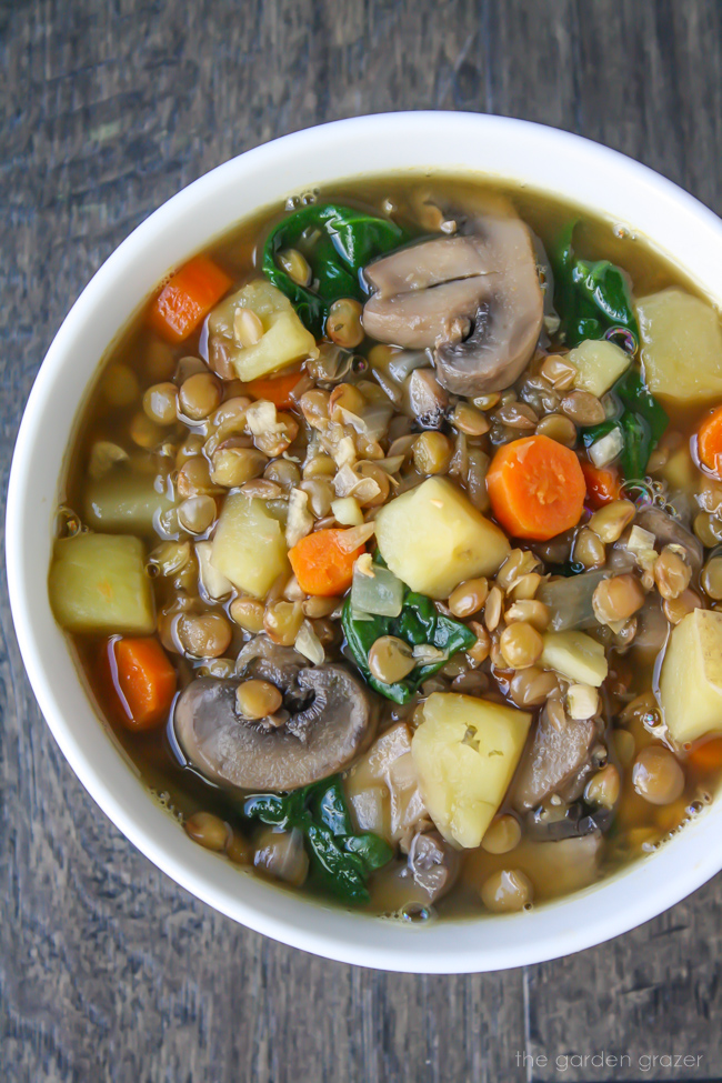 Bowl of lentil soup with potato, mushroom, and carrot