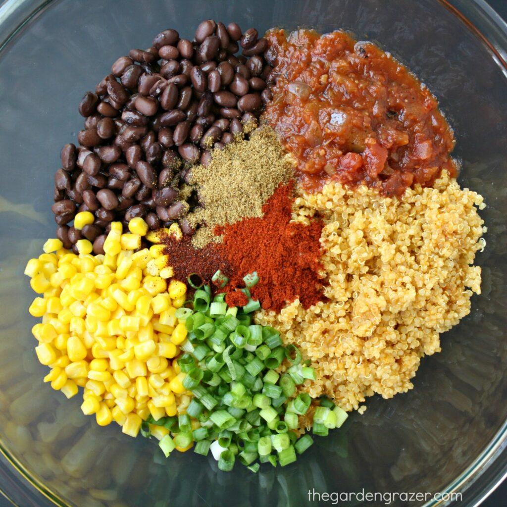 Ingredients for mexican quinoa stuffed peppers in a bowl