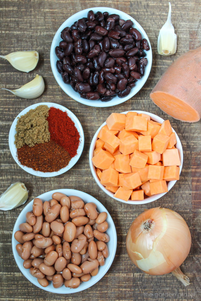 Ingredients on a wooden table for sweet potato chili