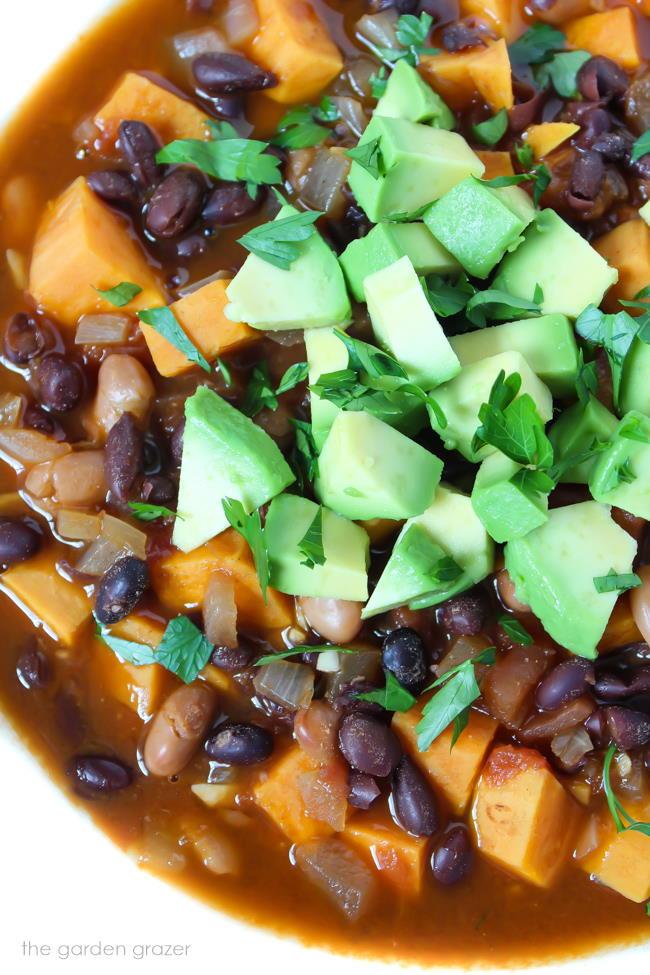 Bowl of vegan sweet potato chili with avocado