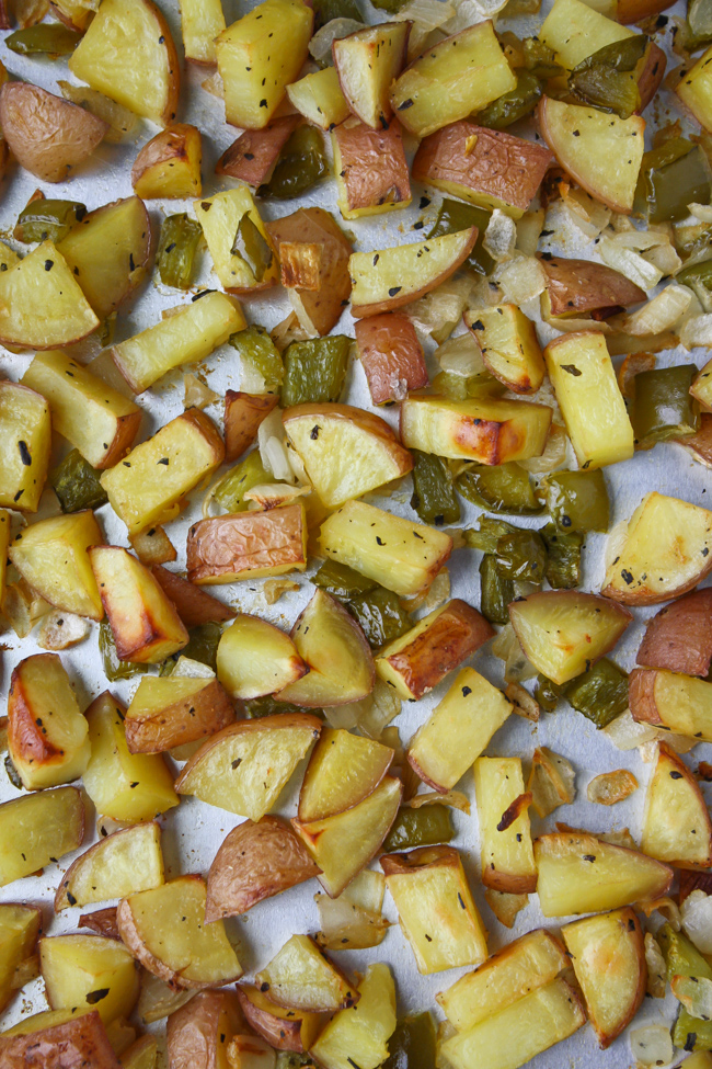 Pan of roasted homestyle potatoes and bell peppers