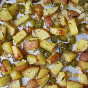 Sheet pan of oven roasted breakfast potatoes with onion and bell pepper