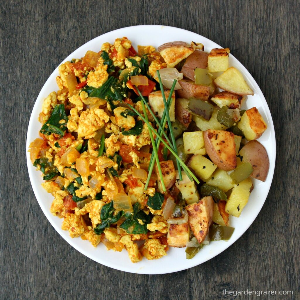 Plate of tofu scramble and roasted breakfast potatoes