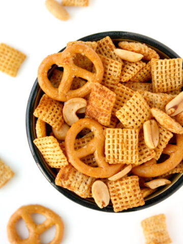 Vegan chex mix with pretzels in a small bowl