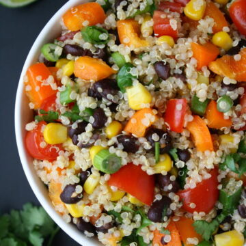 Bowl of Mexican Quinoa Salad with cilantro and lime