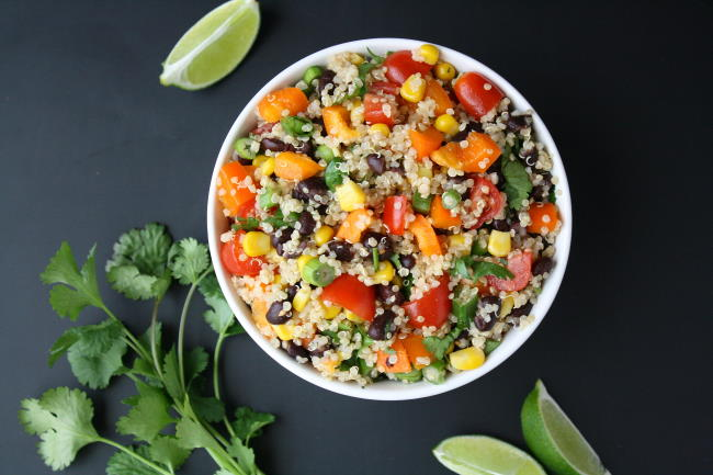 Vegan Mexican-inspired quinoa salad in a bowl with cilantro and lime