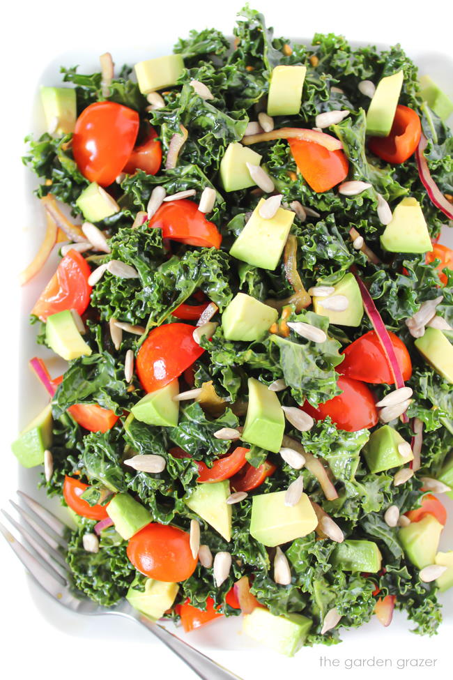 Vegan marinated kale salad with tomatoes on a plate