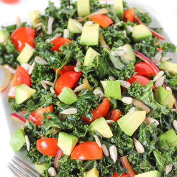 Marinated kale salad with avocado, tomato, onion