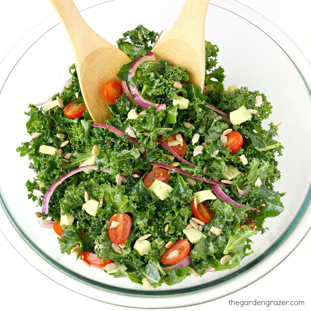 Bowl of marinated kale salad with tomato