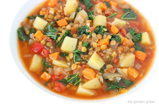 Vegan kale and potato soup with lentils in a bowl