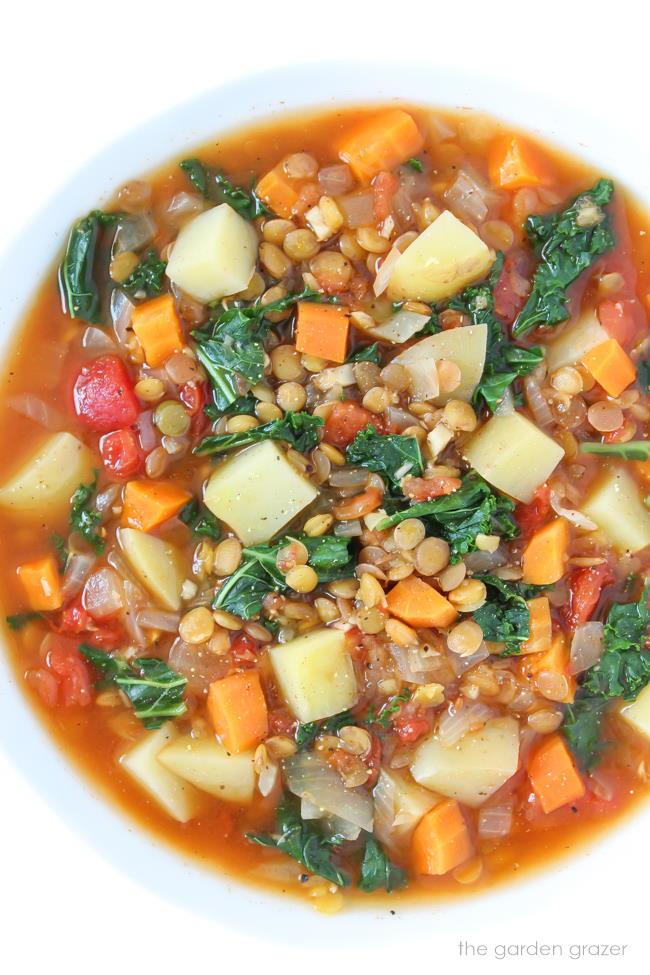 Kale Potato Soup with lentils in a bowl