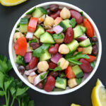 Mediterranean bean salad with herbs and lemon in a small bowl