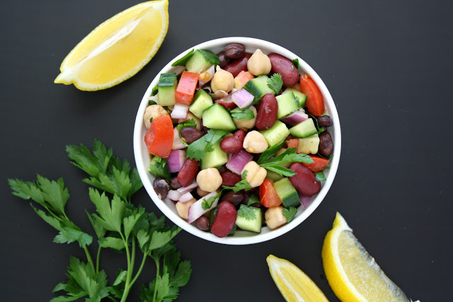 Bowl of Mediterranean salad with beans, herbs, and lemon