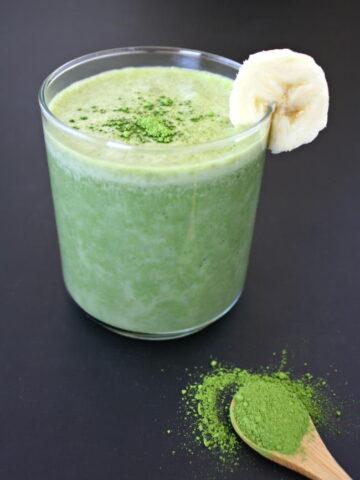 Small glass of vegan banana matcha smoothie