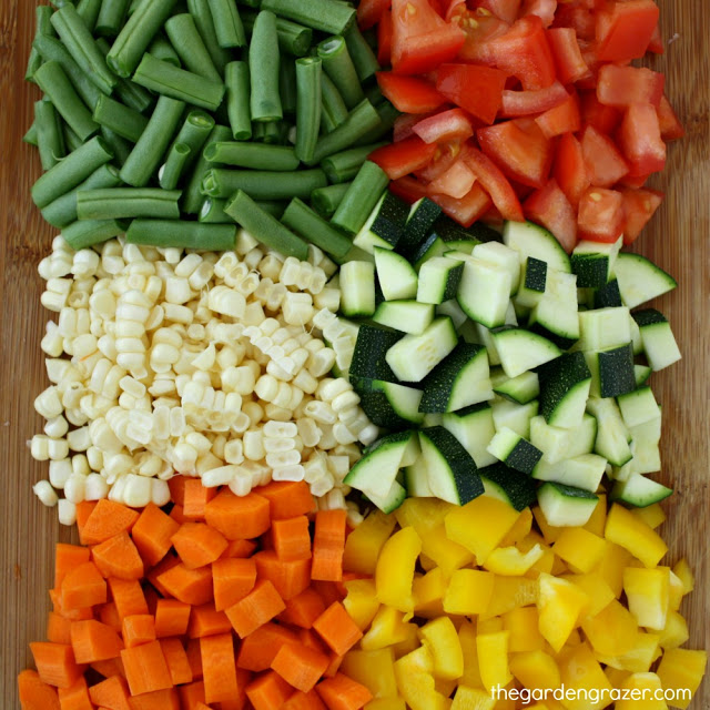 Raw vegetables diced on a cutting board ready for soup