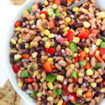 Texas Caviar in a large bowl with spoon and chips