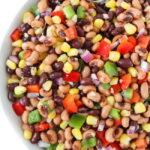 Healthy vegan cowboy caviar in a bowl with spoon