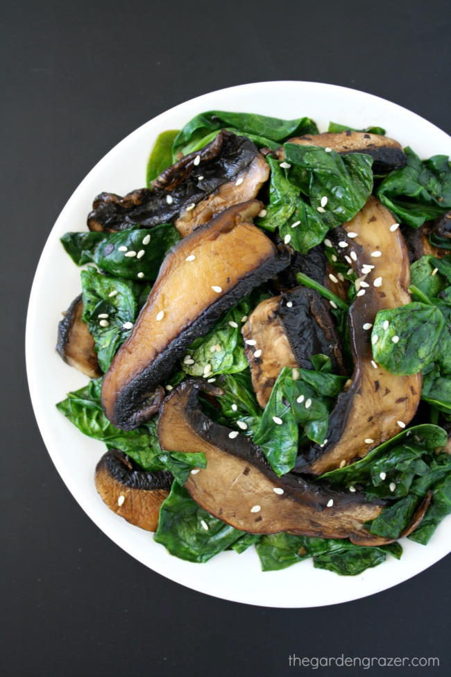 Sautéed mushrooms and spinach on a white plate