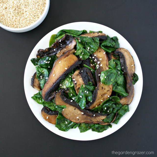 Plate of cooked portobello mushrooms with spinach