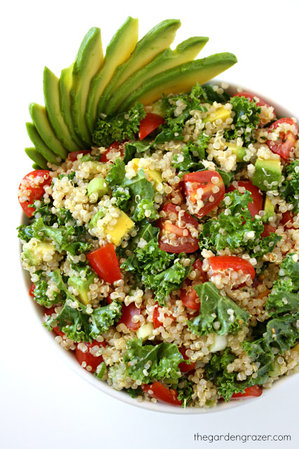 Vegan Avocado Quinoa Kale Salad with tomatoes in a bowl