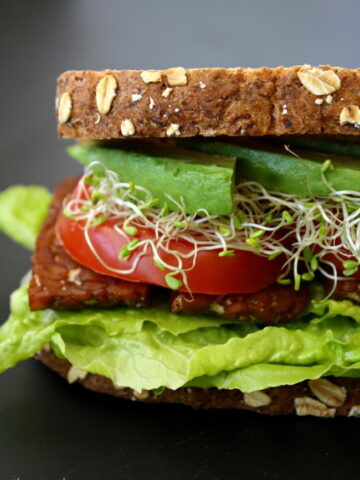 Side view of the vegan BLT sandwich with tempeh bacon