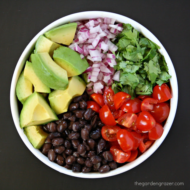 Ingredients for guacamole in a bowl waiting to be combined