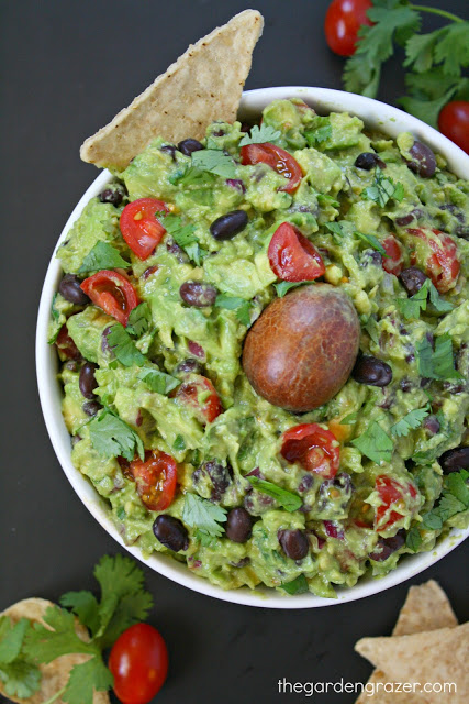 Fiesta black bean guacamole in a bowl with chips