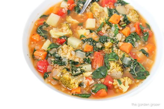 Bowl of quinoa potato soup with kale, spinach, broccoli
