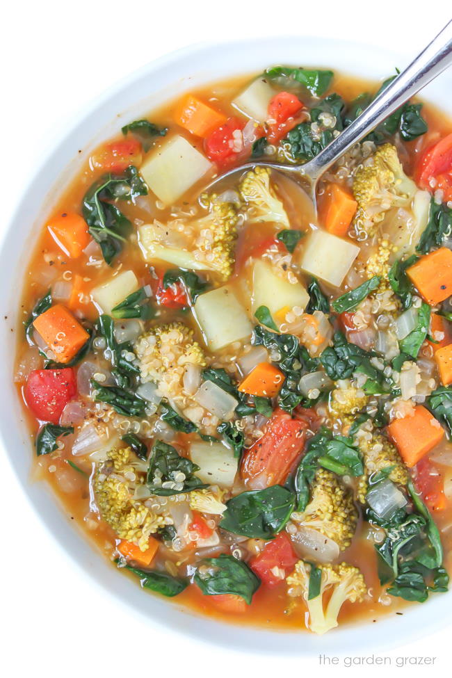 vegan quinoa potato soup in a bowl with spoon