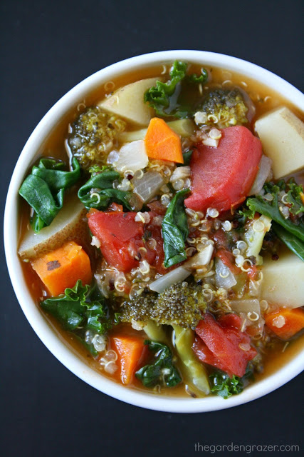 Bowl of vegan quinoa spinach soup with vegetables