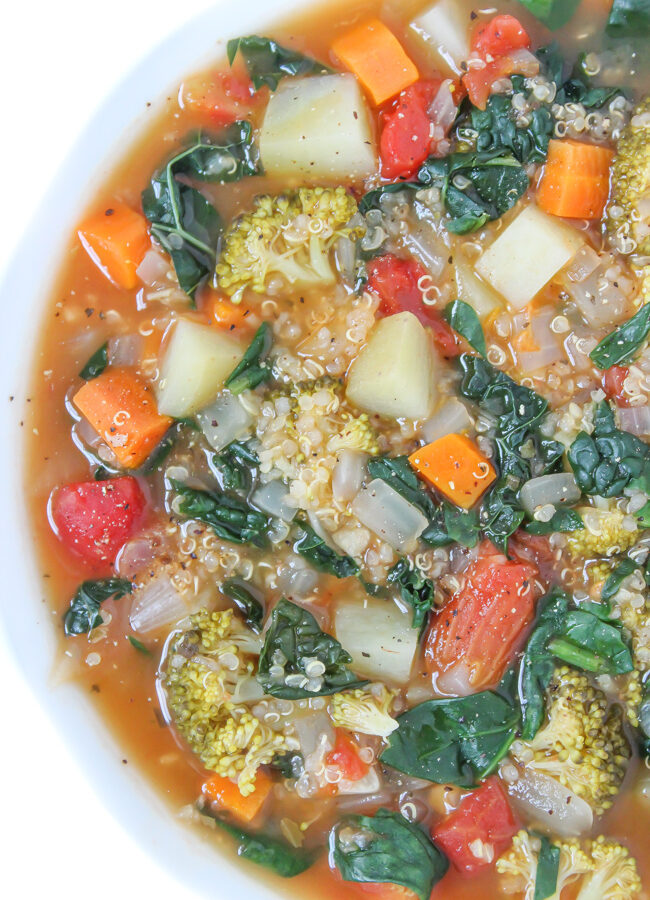 Vegan Quinoa Soup with potato, kale, and spinach in a bowl