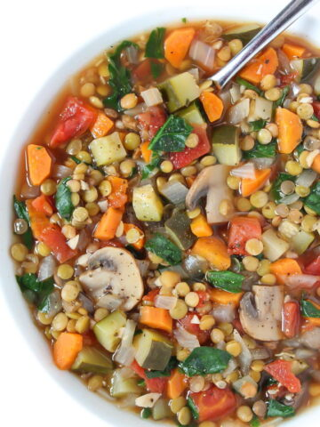 Lentil Vegetable Soup in a bowl with spoon