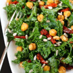 Kale salad with roasted chickpeas on a plate with fork