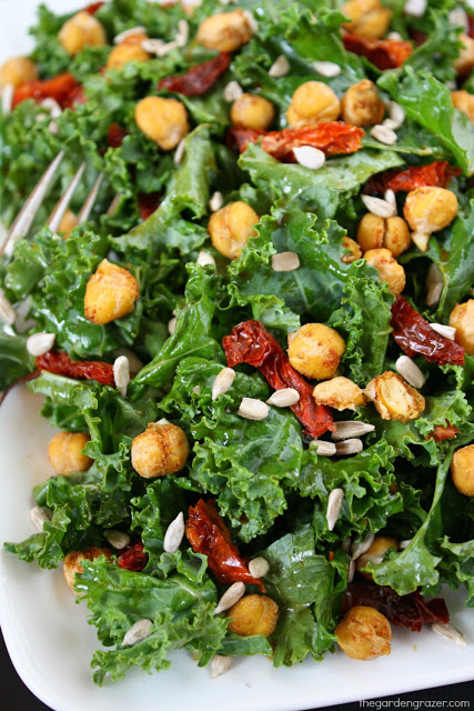Kale Salad with sun-dried tomatoes and roasted chickpeas on a plate