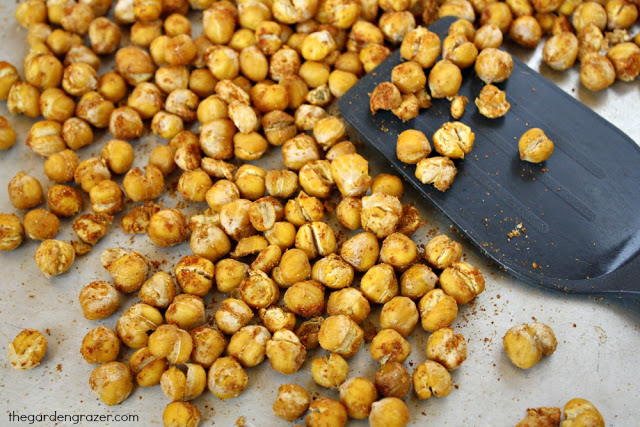Roasted chickpeas on a sheet pan with spatula