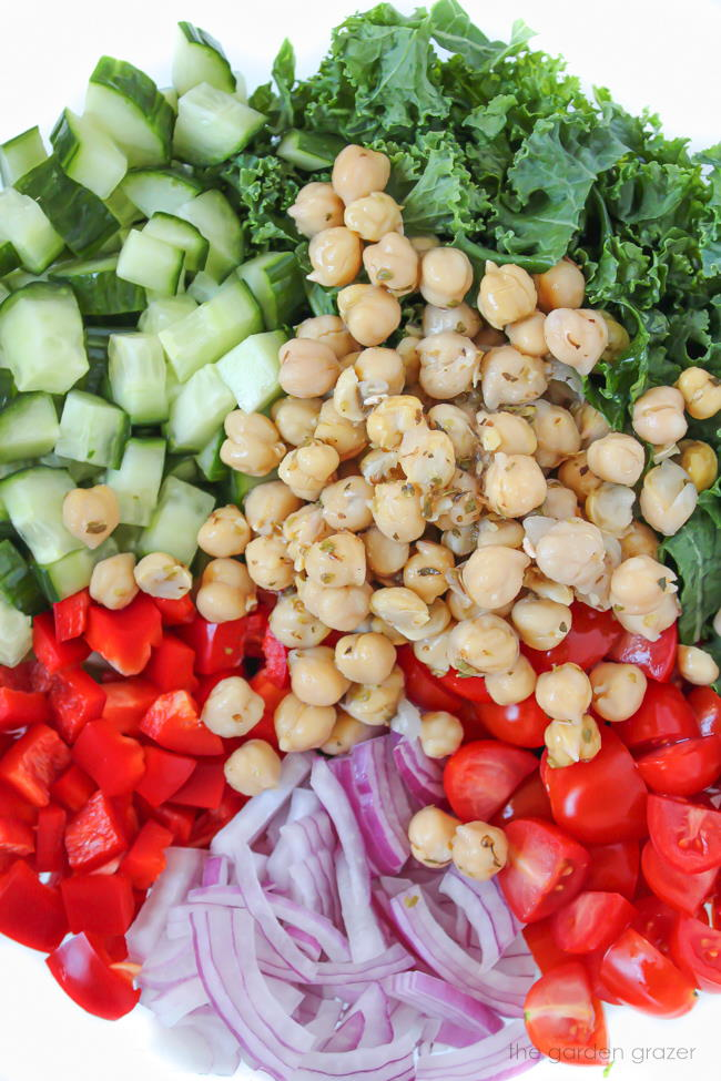 Bowl of Kale Greek Salad with marinated chickpeas