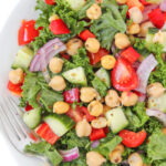 Plate of vegan kale Greek salad with marinated chickpeas