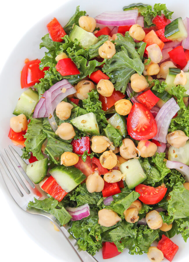 Plate of vegan kale Greek salad with marinated chickpeas