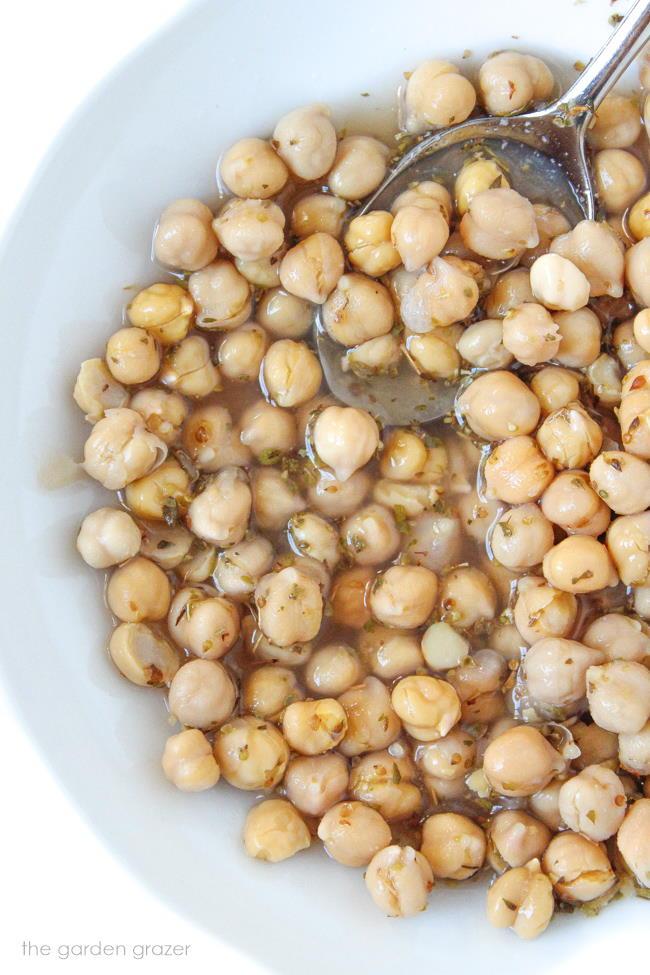 Bowl of marinated chickpeas in lemon-vinegar dressing
