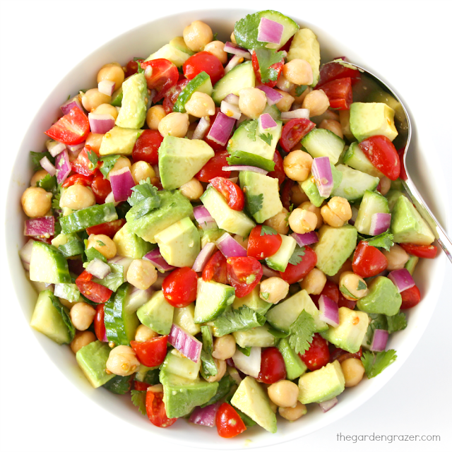 Bowl of avocado salad with tomato, cucumber, and garbanzo