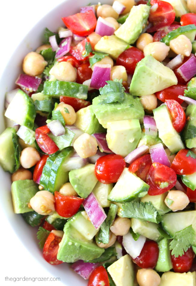 Vegan avocado tomato salad with cucumber in a bowl