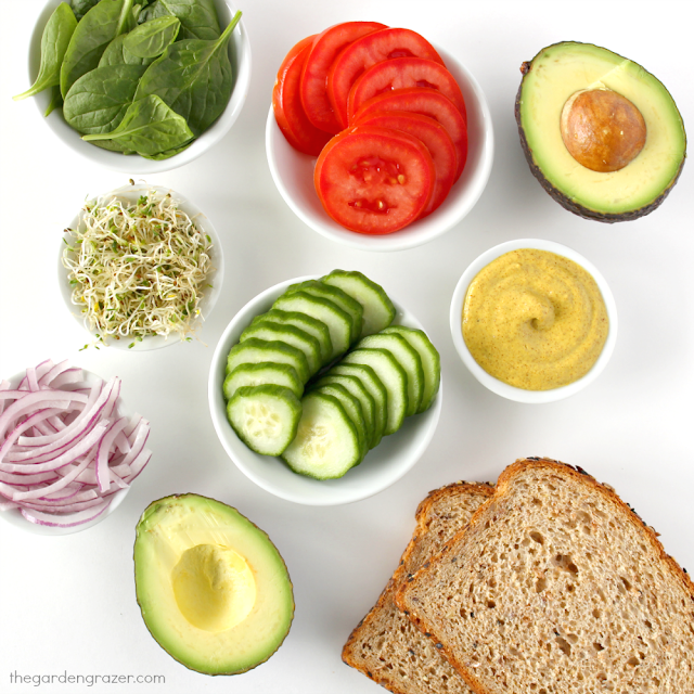 Ingredients laid out on a table for avocado vegetable sandwich