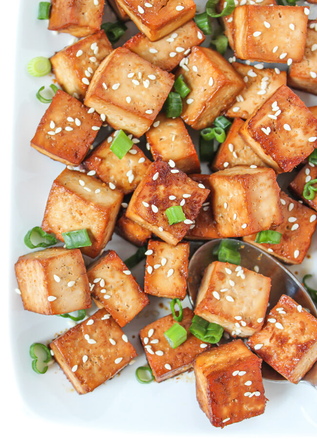 Plate of easy baked tofu cubes with sesame seeds
